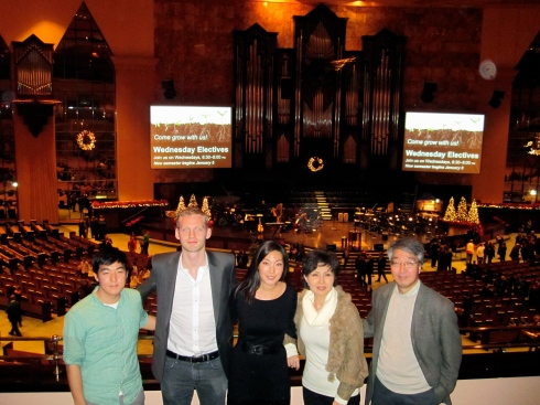 My hosts (together with my friend Nicklas) in front of the main hall of the church